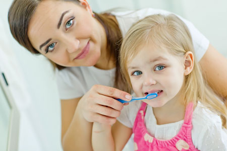 Mom and Daughter brushing their teeth - Pediatric Dentist in Fort Worth, TX